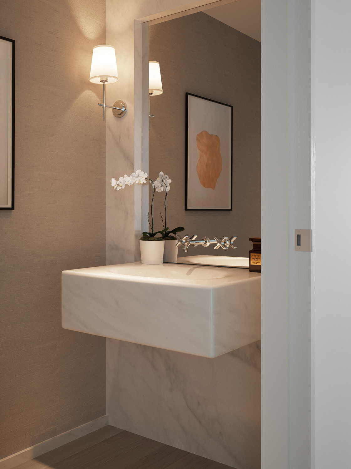 The powder room is intimate and beautifully appointed with a solid carved stone sink and feature wall of Bianco Dolomiti and a continuous solid wood floor. The design is both elegant and modern and leaves room for each owner to express his or her style.